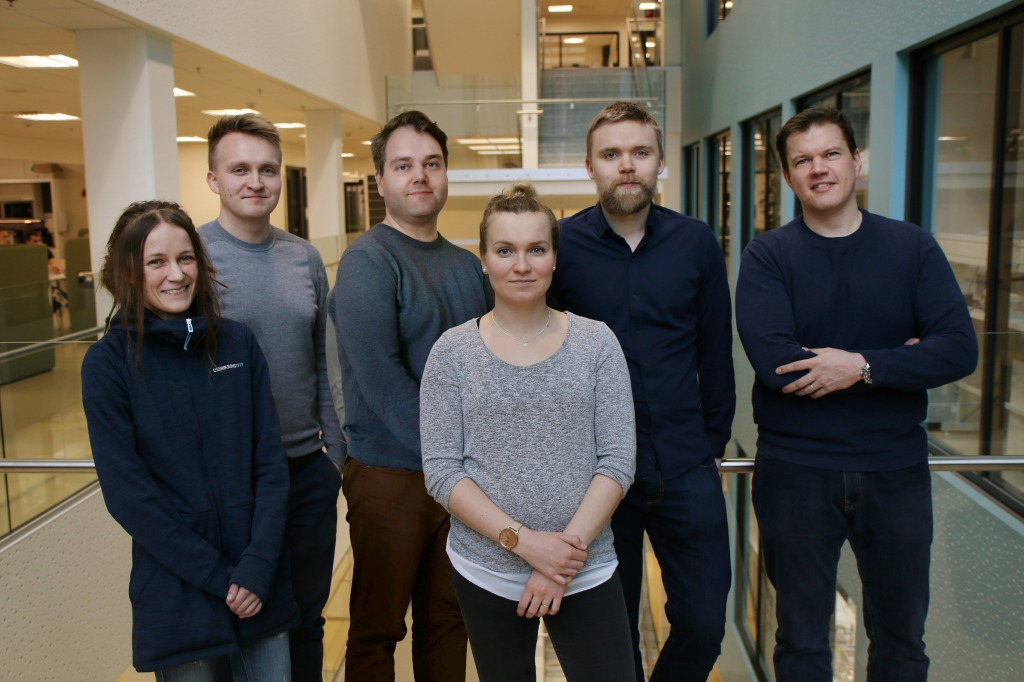 A group photo of 6 people in front of a staircase.